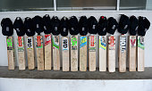 England cricketers put their bats out in their dressing room in memory of Australian cricketer Phil Hughes at R Premadasa Stadium on November 28 2014...