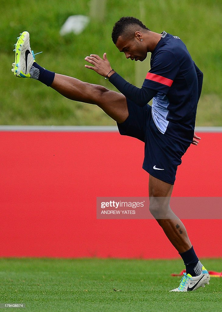 England defender Ashley Cole does high kicks during a training session ahead of their World Cup 2014 European zone group H qualifying football match against Moldova at their St George's Park training complex in Burton-on-Trent, central England, on September 3, 2013.