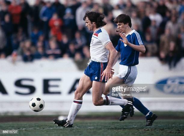 England defender Dave Watson under pressure from Iceland's Larus Gudmundsson during the International friendly in Reykjavik 2nd June 1982 The match...