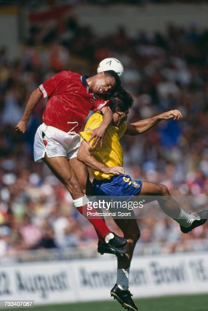 England defender Des Walker and Brazil forward Renato Portaluppi clash heads as they both jump for the ball in the international friendly match...