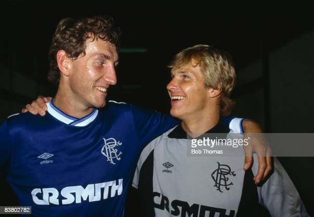 England defender Terry Butcher and goalkeeper Chris Woods after their debut for Glasgow Rangers in a preseason friendly at Ibrox Stadium against...