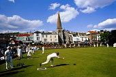 England, Devon, Dawlish, game of bowls in progress on village green