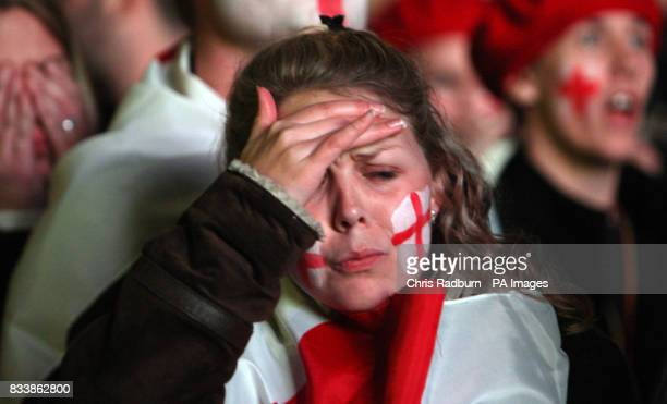 England Fan Helen Povey from London reacts whilst watching the Rugby World Cup Final match near the Eiffel Tower in Paris
