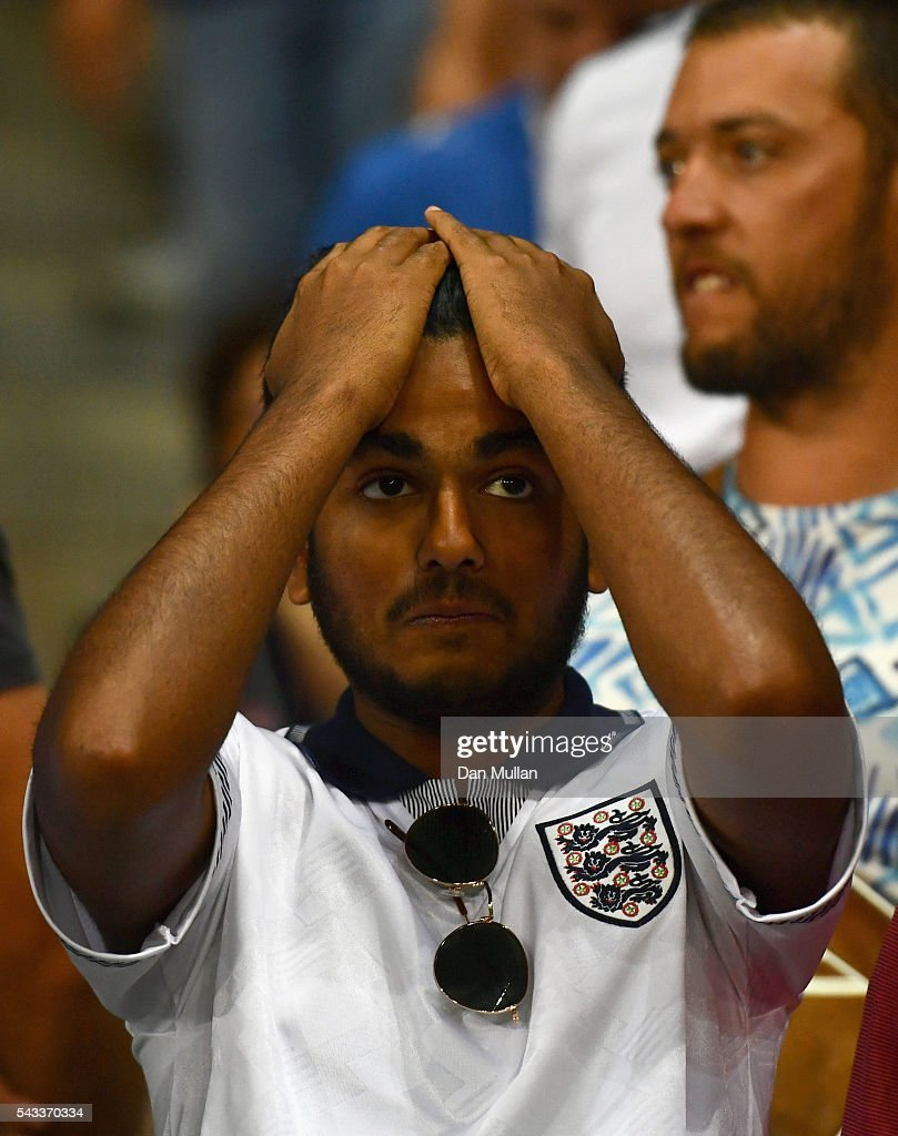England fan shows their dejection after their team's 1-2 defeat in the UEFA EURO 2016 round of 16 match between England and Iceland at Allianz Riviera Stadium on June 27, 2016 in Nice, France.