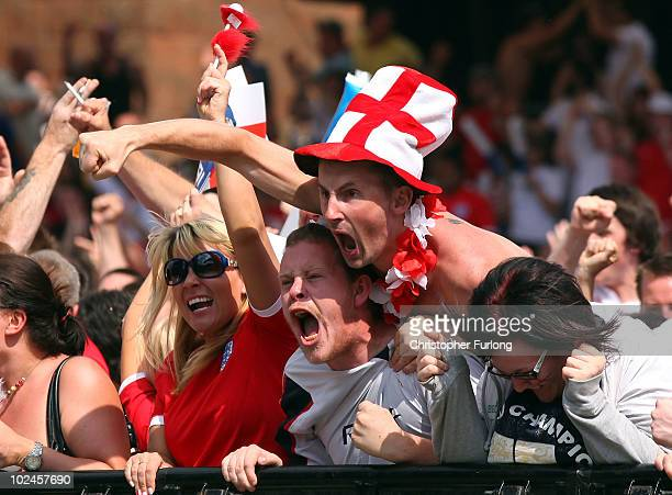 England fans celebrate a goal as they watch the England v Germany World Cup match on a giant screen in the Manchester fan zone on June 27 2010 in...