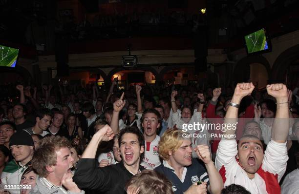England fans celebrate in the Walkabout Bar London after Mark Cueto appears to score a try during the Rugby World Cup Final against South Africa...