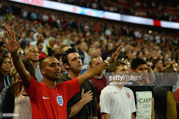 England fans cheer during the International friendly match between England and Norway at Wembley Stadium on September 3 2014 in London England
