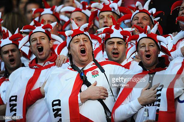 England fans cheer on their team during the RBS 6 Nations Championship match between England and Italy at Twickenham Stadium on February 12 2011 in...