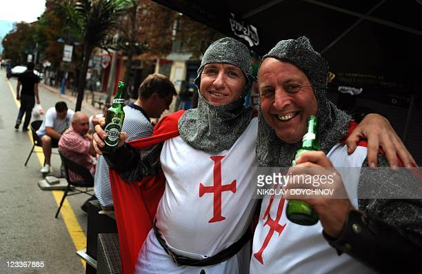 England fans dressed as crusaders pose with beer in Sofia on September 2 2011 England will play a Euro 2012 qualifying football match against...