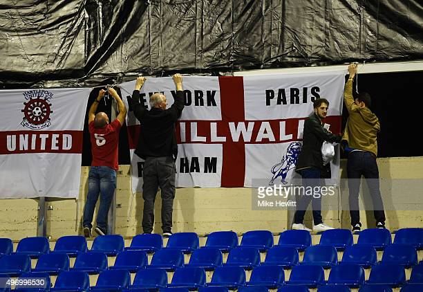 England fans fix flags prior to the international friendly match between Spain and England at Jose Rico Perez Stadium on November 13 2015 in Alicante...