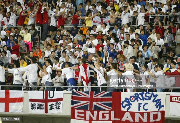 England fans form a conga around Niigata's Big Swan satdium as England lead Denmark 30 during the World Cup second round match between England and...