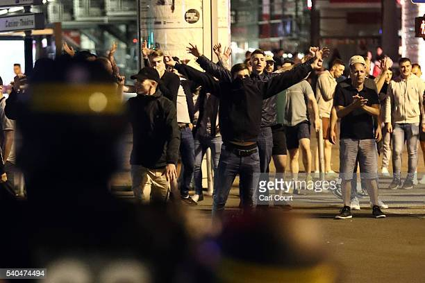 England fans gesture at police officers during clashes aon June 16 2016 in Lille France Police used tear gas and pepper spray on the fans in a bid to...
