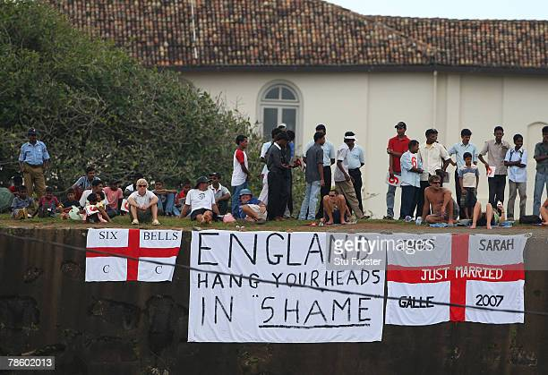 England 'Fans' hang a banner on the fort wall to express their dissatisfaction with yesterday's performance during day 4 of the 3rd and final Test...