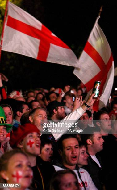 England fans in front of the Eiffel Tower Paris watching England's Rugby World Cup Final match against South Africa