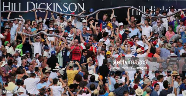 England fans join the plastic beer glasses together in large snake during day two of the Third Investec Ashes test match at Old Trafford Cricket...