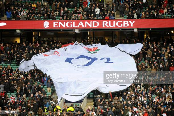England fans pass a giant replica shirt across the stand before the game