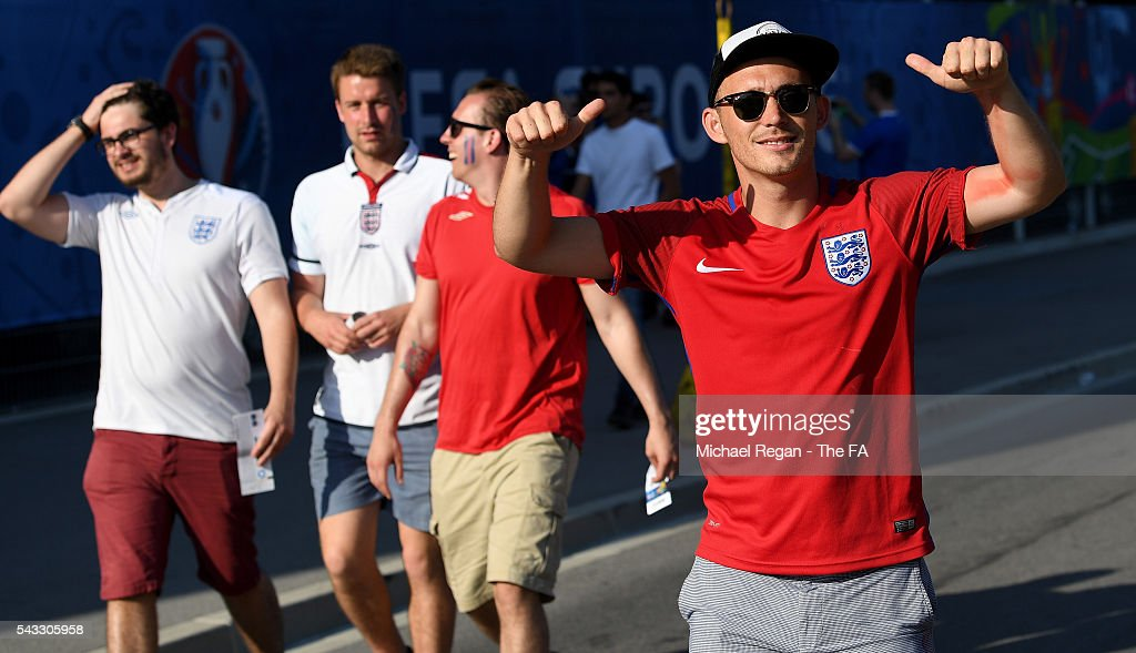 England fans pose for photographs on their way to the stadium prior to the UEFA EURO 2016 round of 16 match between England and Iceland at Allianz Riviera Stadium on June 27, 2016 in Nice, France.