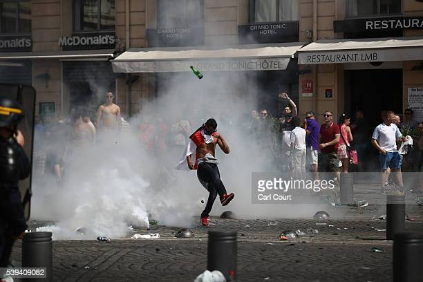 England fans react after police sprayed tear gas during clashes ahead of the game against Russia later today on June 11 2016 in Marseille France...