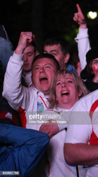 England fans react as they watch the Rugby World Cup Final match near the Eiffel Tower in Paris