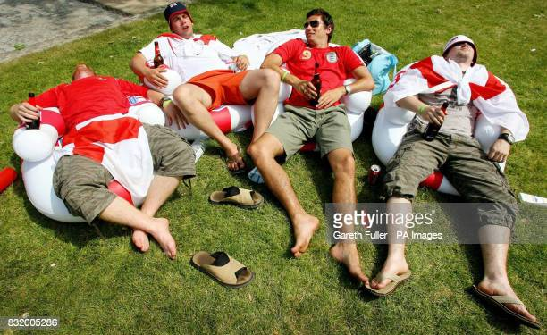 England fans Shaughan Hawks Daniel Smith Olly Freeman and Adam Waters all from Kent relax on inflatable chairs after spending the night sleeping in a...