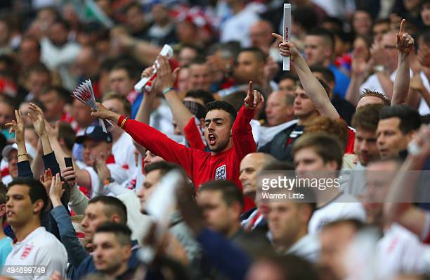 England fans show their colours during the international friendly match between England and Peru at Wembley Stadium on May 30 2014 in London England