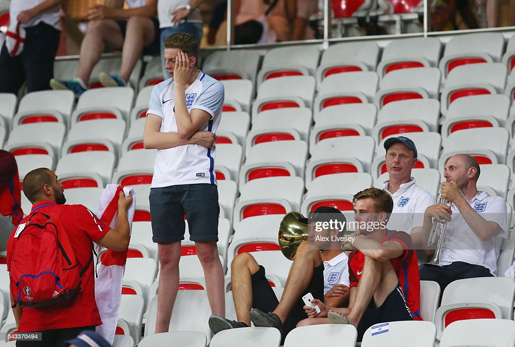 England fans show their dejection after their team's 1-2 defeat in the UEFA EURO 2016 round of 16 match between England and Iceland at Allianz Riviera Stadium on June 27, 2016 in Nice, France.