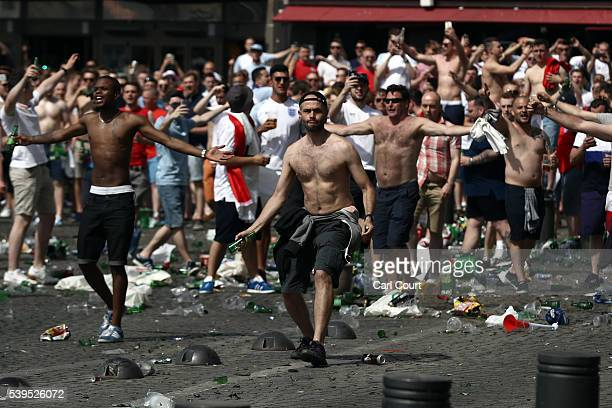 England fans throw bottles and clash with police ahead of the game against Russia later today on June 11 2016 in Marseille France Football fans from...