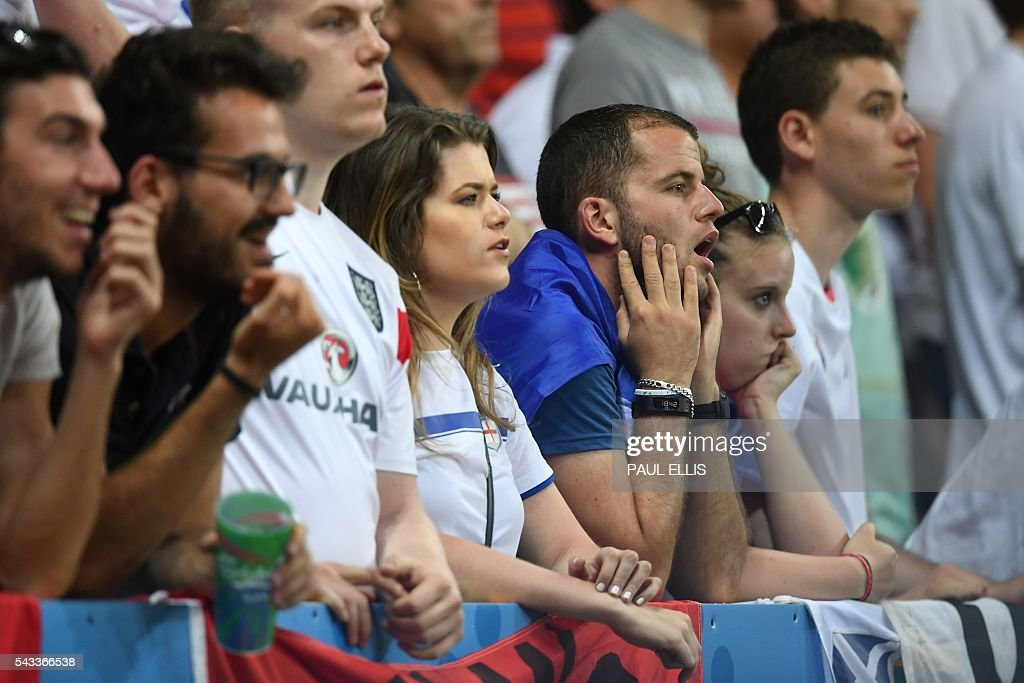 England fans watch the match at 1-2 to Iceland during Euro 2016 round of 16 football match between England and Iceland at the Allianz Riviera stadium in Nice on June 27, 2016. / AFP / PAUL