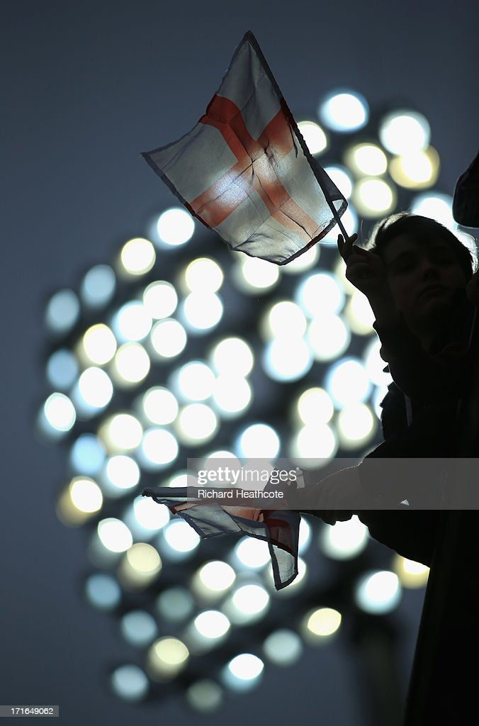 England fans wave flags as the match is delayed due to rain during the 2nd Natwest International T20 match between England and New Zealand at The Kia Oval on June 27, 2013 in London, England.