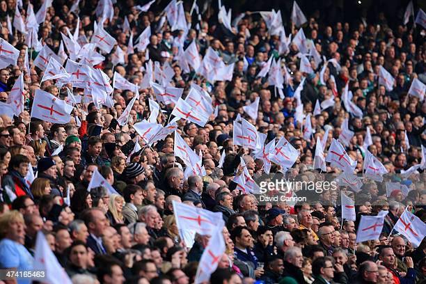 England fans wave flags during the RBS Six Nations match between England and Ireland at Twickenham Stadium on February 22 2014 in London England