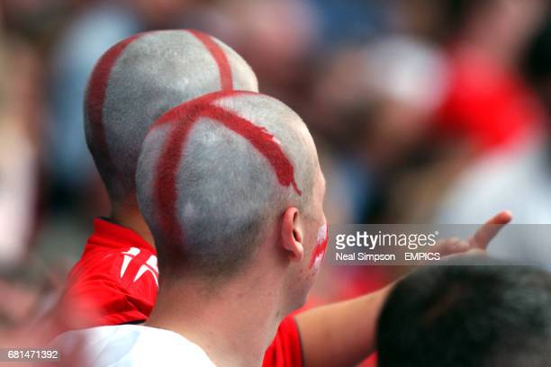 England fans with specially painted shaven heads as the St George's cross