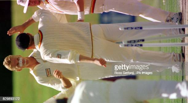 England fast bowler Alan Mullally is congratulated by teammates after taking the wicket of Northern Districts Mathew Bell on the first day of the...