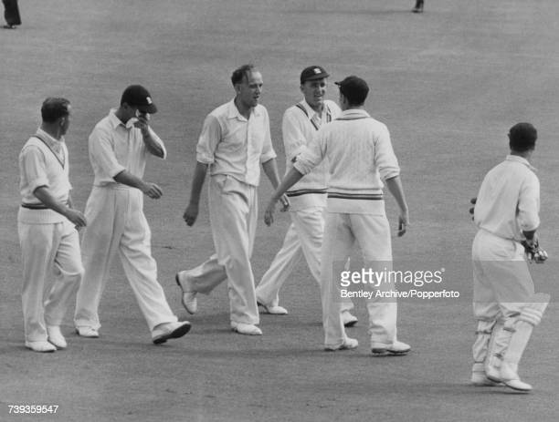 England fast bowler Frank Tyson with other members of the MCC team as he leaves the field at the end of the Second Test against Australia at Sydney...