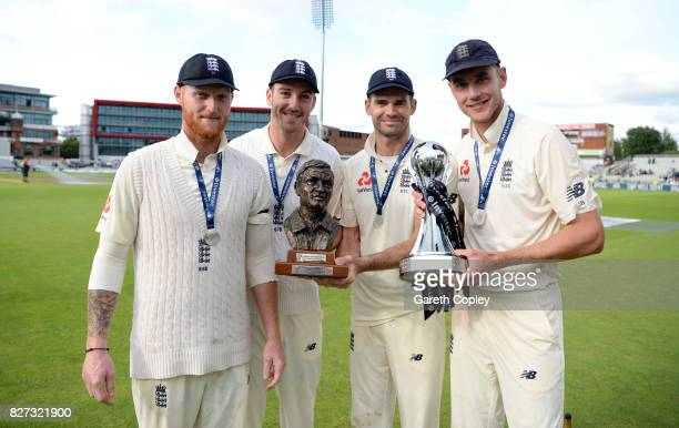 England fast bowlers Ben Stokes Toby RolandJones James Anderson and Stuart Broad celebrate with the series trophy after winning the Investec Test...