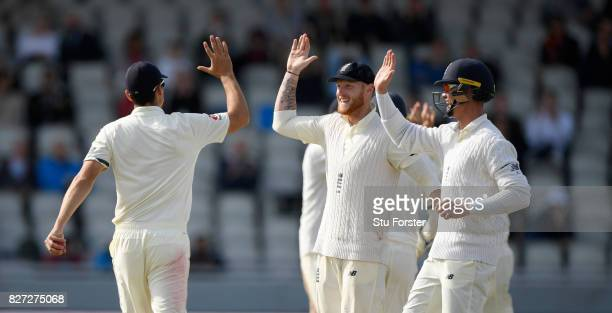 England fielder Alastair Cook is congratulated by Ben Stokes and Keaton Jennings after catching Quinton du Kock during day four of the 4th Investec...