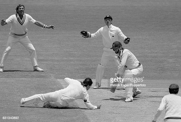 England fielder Allan Lamb at silly point dives to make an attempted catch off Steve Waugh of Australia during the 2nd Test match between Australia...