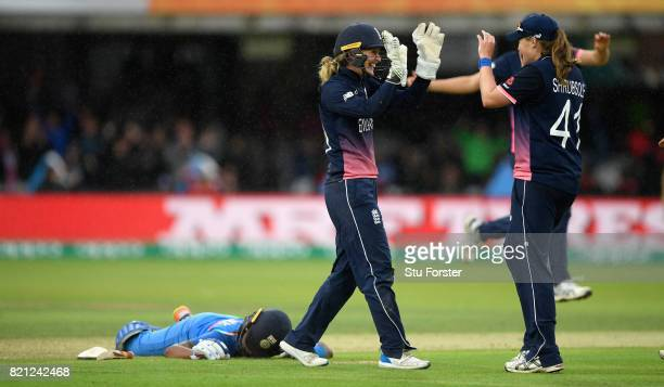 England fielder Anya Shrubsole and Sarah Taylor celebrate after the pair had combined to run out Pandey during the ICC Women's World Cup 2017 Final...