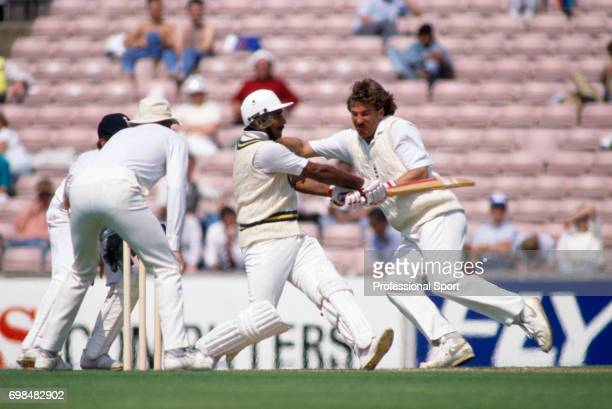 England fielder Ian Botham takes evasive action as Pakistan batsman Javed Miandad pulls a delivery during his innings of 260 in the 5th Test match...