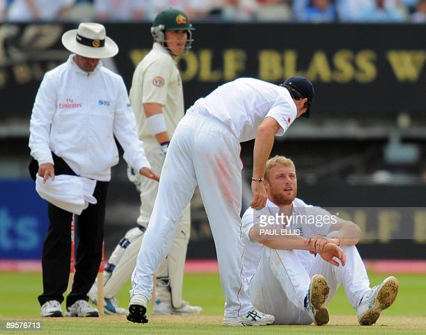 England fielder James Anderson checks on England bowler Andrew Flintoff after he fell to the ground while bowling on the final day of the third Ashes...