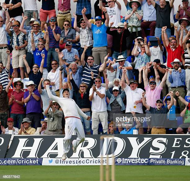 England fielder Joe Root celebrates after catching Australia batsman Josh Hazlewood to win the match during day four of the 1st Investec Ashes Test...