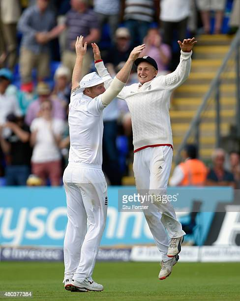 England fielder Joe Root celebrates with Ben Stokes after catching Australia batsman Josh Hazlewood to win the match during day four of the 1st...