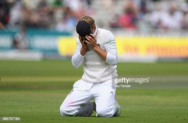 England fielder Joe Root reacts after dropping a catch off the bowling of James Anderson during day two of the 3rd Investec Test Match between...