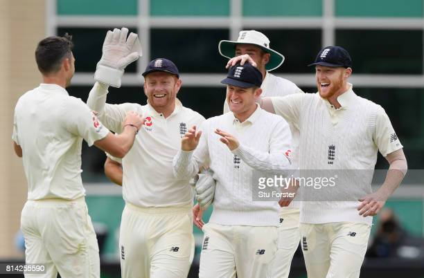 England fielder Liam Dawson is congratulated by team mates after catching out Dean Elgar during day one of the 2nd Investec Test match between...