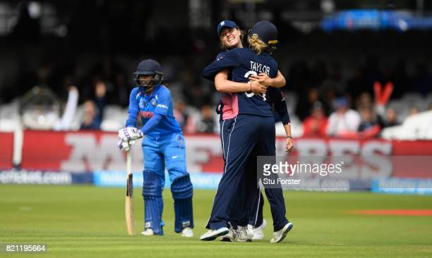 England fielder Natalie Sciver is congratulated after running out India batsman Mithali Raj during the ICC Women's World Cup 2017 Final between...