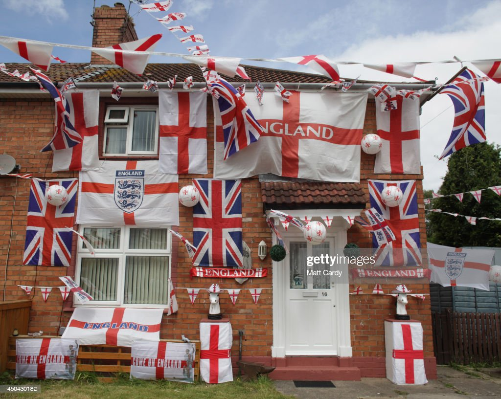 England flags adorn a house in a street in the Knowle West area of Bristol on June 11, 2014 in Bristol, England. The football World Cup, which kicks off in Sao Paulo on June 12, 2014 with Brazil versus Croatia, has been beset by construction delays, protests and strikes. However, despite the problems and the fact that it is being hosted 1000s of miles away in Brazil the tournament is being widely anticipated throughout the UK with many homes, business and cars beginning to display England flags and other football paraphernalia.