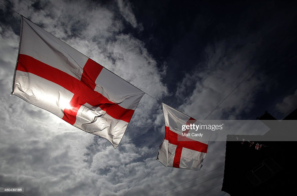 England flags fly in a street in the Knowle West area of Bristol on June 11, 2014 in Bristol, England. The football World Cup, which kicks off in Sao Paulo on June 12, 2014 with Brazil versus Croatia, has been beset by construction delays, protests and strikes. However, despite the problems and the fact that it is being hosted 1000s of miles away in Brazil the tournament is being widely anticipated throughout the UK with many homes, business and cars beginning to display England flags and other football paraphernalia.
