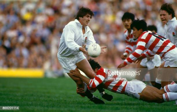 England fly half Stuart Barnes offloads the ball despite being tackled during a match against Japan at Twickenham on October 11 1986 in London England
