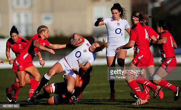 England flyhalf Ceri Large makes a break during the Six Nations championship match between Wales and England at St Helens RFC on February 8 2015 in...
