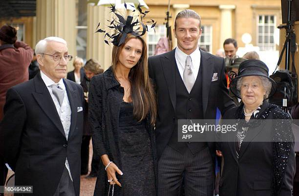England football captain David Beckham stands with his wife Victoria and his maternal grandparents Joseph and Peggy West as he shows off the OBE he...