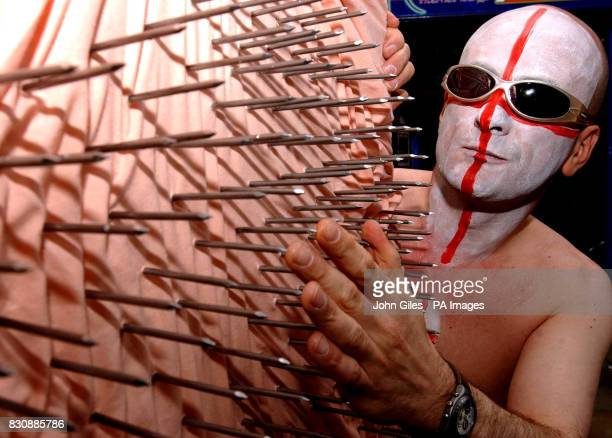 England football fan Michael Mime of York prepares to watch Friday's World Cup Quarter final between England and Brazil from an unusual position * He...